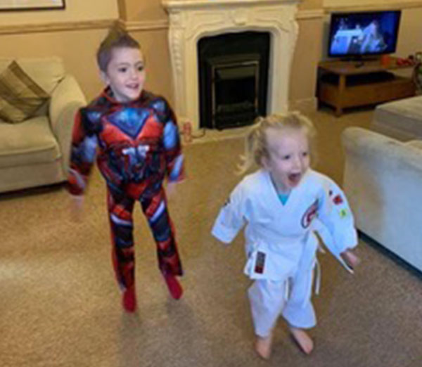 Children age 3 to 6 enjoying a live streamed karate lesson